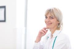 Portrait of smiling elderly doctor Stock Image