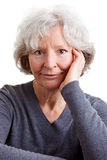 Portrait of smiling elderly woman Royalty Free Stock Photography