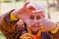 Portrait of smiling elderly woman Royalty Free Stock Photos