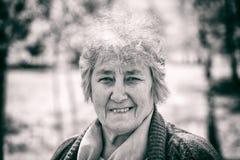 Portrait of smiling elderly woman Stock Image