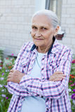 Portrait of smiling elderly woman. A photo on the hause background Royalty Free Stock Photography