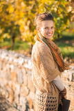 Portrait of smiling elegant brunette woman in autumn park Stock Images