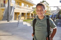Portrait of smiling elementary school boy with his backpack royalty free stock photos