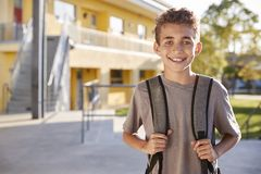 Portrait of smiling elementary school boy with his backpack royalty free stock photo