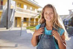 Portrait of smiling elementary school girl with her backpack stock photos