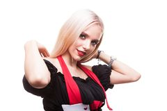 Beautiful entertainer girl in casino type outfit over white back. Portrait of smiling entertainer girl in casino type outfit over white background in studio Royalty Free Stock Images