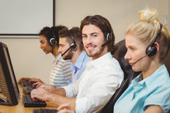 Portrait of smiling executive in call center Stock Photography