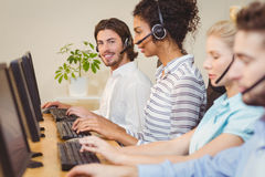 Portrait of smiling executive in call center Stock Photo
