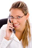 Portrait of smiling executive talking on mobile Stock Photography