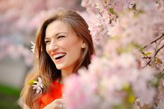 Portrait of smiling face Beautiful brunette woman in spring trees background Royalty Free Stock Photography