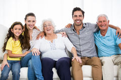 Portrait of smiling family with arm around Royalty Free Stock Photos
