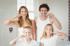 Portrait of smiling family brushing teeth. Portrait of smiling happy family brushing teeth at home Stock Photos