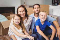 Portrait of smiling family with cardboard boxes Royalty Free Stock Photo