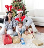 Portrait of a smiling family at Christmas time Stock Photos