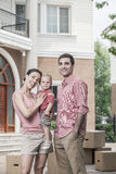 Portrait of smiling family in front of their new home Royalty Free Stock Images