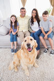 Portrait of smiling family with Golden Retriever Stock Image