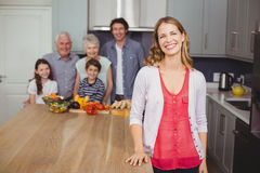 Portrait of smiling family in kitchen Stock Photo