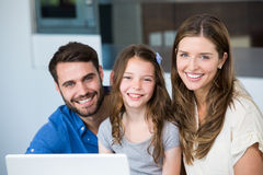 Portrait of smiling family with laptop Stock Image