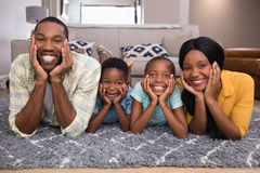 Portrait of smiling family lying on rug Royalty Free Stock Image
