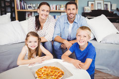 Portrait of smiling family with pizza Royalty Free Stock Photography