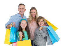 Portrait of smiling family with shopping bag Royalty Free Stock Photo
