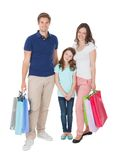 Portrait of smiling family with shopping bags Stock Photography