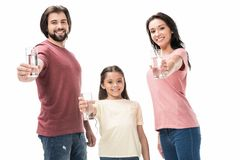portrait of smiling family showing glasses of water in hands stock photo