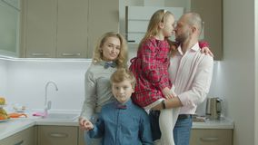 Portrait of smiling family with siblings in kitchen stock footage