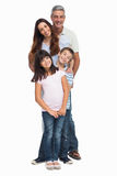 Portrait of a smiling family in single file stock photos