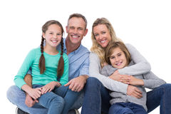 Portrait of a smiling family sitting on the floor Royalty Free Stock Images