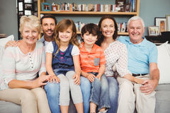 Portrait of smiling family sitting on sofa. At home Royalty Free Stock Photography