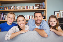 Portrait of smiling family at sofa Royalty Free Stock Photography