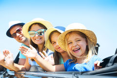 Portrait of a smiling family with two children at beach in the c Stock Image