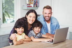 Portrait of smiling family using laptop Stock Images