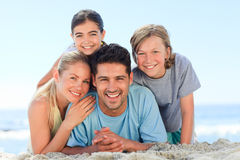 Portrait of a smiling famiy at the beach Stock Photo