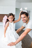 Portrait of smiling father with butterfly headband and daughter Royalty Free Stock Photo