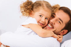 Portrait of smiling father and cute daughter Royalty Free Stock Photos