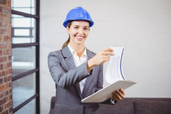 Portrait of smiling female architect holding clipboard Stock Photography