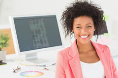 Portrait of a smiling female artist at desk with computer Stock Photos