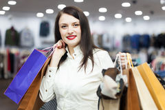Portrait of smiling female buyer. With shopping bags Royalty Free Stock Photography