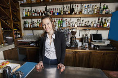 Portrait of smiling female cashier at counter in restaurant Stock Photography