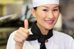 Portrait of smiling female cook gesturing thumbs up Stock Photography