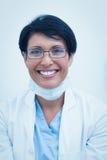 Portrait of smiling female dentist Stock Image