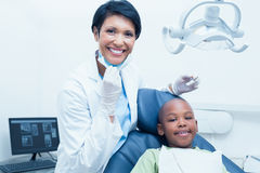 Portrait of smiling female dentist examining boys teeth Royalty Free Stock Photos