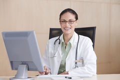Portrait of smiling female doctor Stock Image
