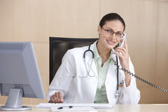 Portrait of smiling female doctor Stock Photo