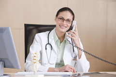 Portrait of smiling female doctor Stock Photography