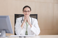 Portrait of smiling female doctor Stock Photos
