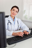 Portrait of a smiling female doctor Stock Image