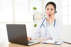 Portrait of smiling female doctor in conversation royalty free stock images